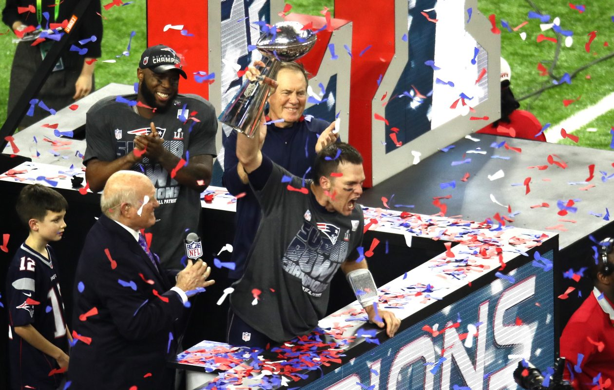 Tom Brady #12 of the New England Patriots raises the Lombardi Trophy after defeating the Atlanta Falcons during Super Bowl 51 at NRG Stadium on February 5, 2017 in Houston, Texas. The Patriots defeated the Falcons 34-28.  (Photo by Ezra Shaw/Getty Images)