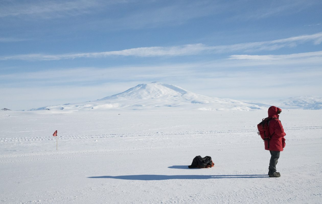 This photo was shot on the Ross Ice Shelf, with Mount Erebus in the distance, in Antarctica, in November. (Jonathan Corum/The New York Times)