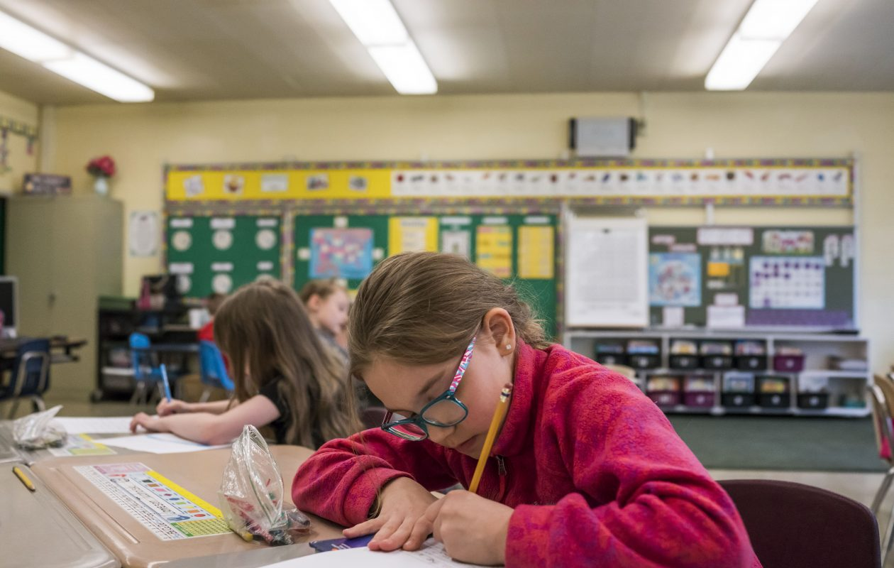 Isabella Gascon works on a class assignment in a first-grade class at Clinton Street Elementary School in the West Seneca School District in this May 10, 2017, file photo. (Derek Gee/Buffalo News)