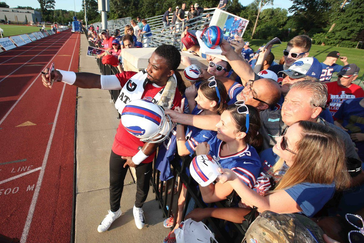 Bills QB Tyrod Taylor takes a selfie with fans after the first day of training camp (James P. McCoy/Buffalo News)