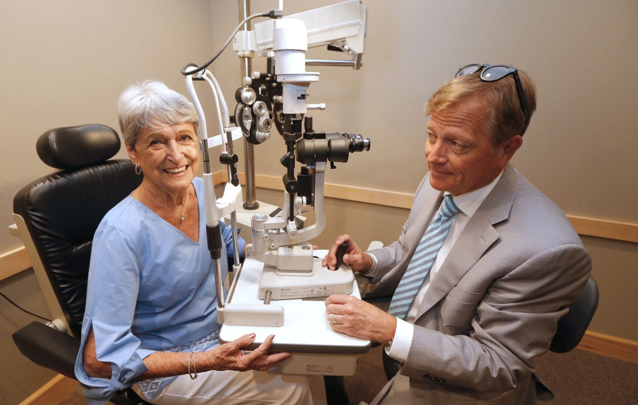 Betty Fecteau, left, 85, of West Seneca, had a tiny stent surgically placed into her right eye in May by Dr. Paul C. Holmwood, right, an ophthalmologist with Eye Care & Vision Associates, which has four offices in Western New York. The stent, the size of an eyelash, makes glaucoma treatment easier. (Robert Kirkham/Buffalo News)