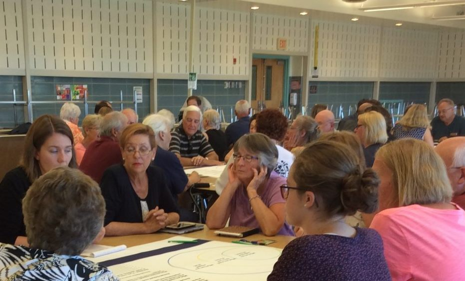 Grand Island residents break into groups to discuss what they would like to see offered in a Community Center. (Nancy Fischer/Buffalo News)