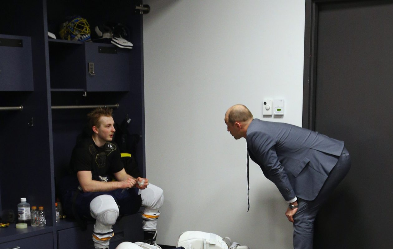Goalie coach Andrew Allen, right, talks with Linus Ullmark following a game in 2016. (Getty Images)