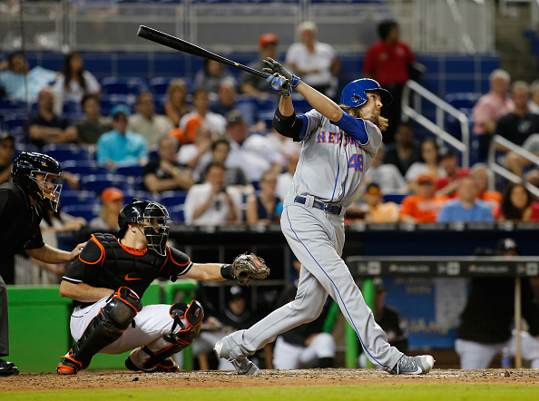 MIAMI, FL - JUNE 04:  Pitcher Jacob deGrom #48 of the New York Mets pinch hits in the ninth inning in front of catcher J.T. Realmuto #11 of the Miami Marlins at Marlins Park on June 4, 2016 in Miami, Florida.deGrom popped out to second base.  (Photo by Joe Skipper/Getty Images)