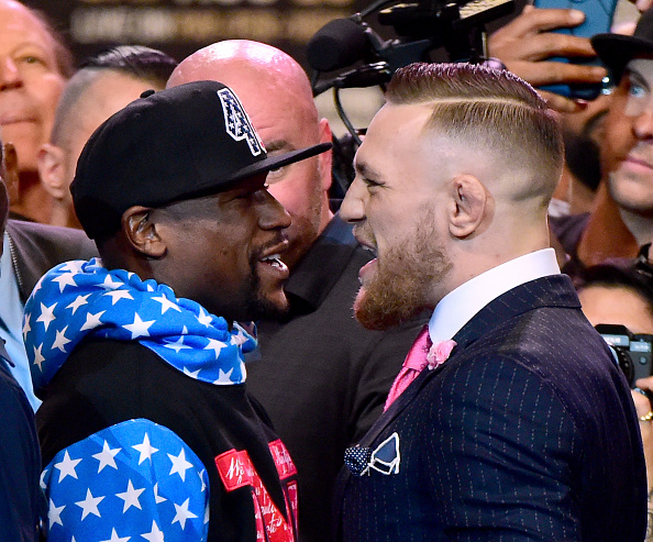 LOS ANGELES, CA - JULY 11:  Floyd Mayweather Jr. and Conor McGregor stand face to face during the Floyd Mayweather Jr. v Conor McGregor World Press Tour at Staples Center on July 11, 2017 in Los Angeles, California.  (Photo by Harry How/Getty Images)