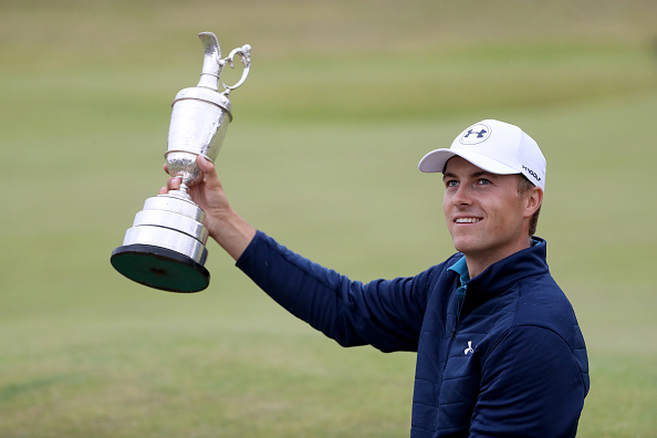 Jordan Spieth celebrates victory as he poses with the Claret Jug on the 18th green during the final round of the 146th Open Championship at Royal Birkdale on July 23, 2017, in Southport, England.  (Photo by Christian Petersen/Getty Images)