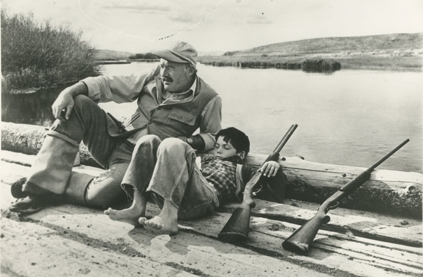 Ernest Hemingway and son Gregory relax during a day shooting pheasant, in Sun Valley, Idaho. (News file photo)