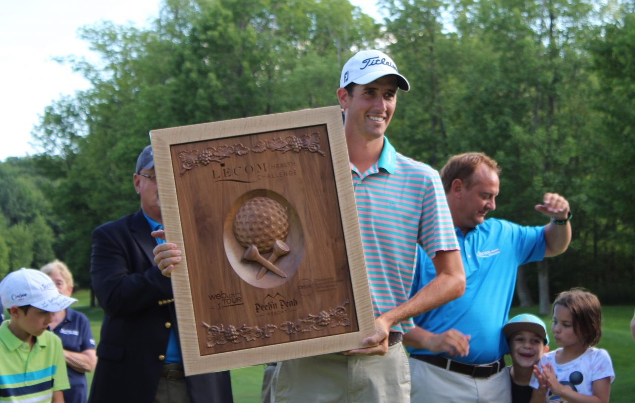 Chesson Hadley accepts the trophy for his third Web.com tour title. (Photo via LECOM Health Challenge)