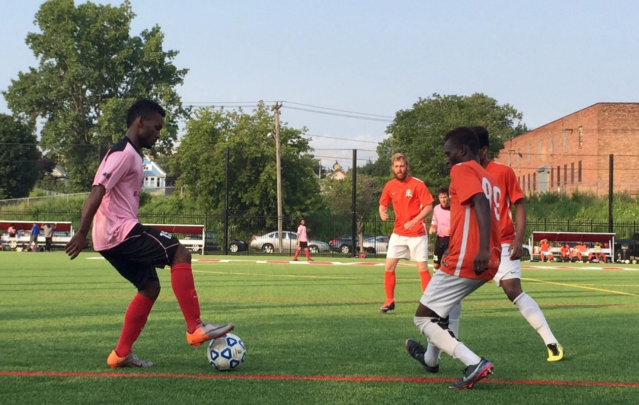 BUSS, in orange, proved too much for Abdulaziz Abdulaziz, left, and Buffalo Bantu FC. (Ben Tsujimoto/Buffalo News)