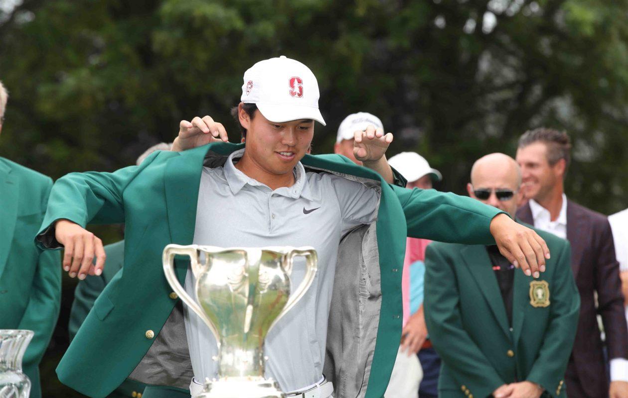 Brandon Wu slips on the green jacket after winning the 2017 Porter Cup (James P. McCoy/Buffalo News)