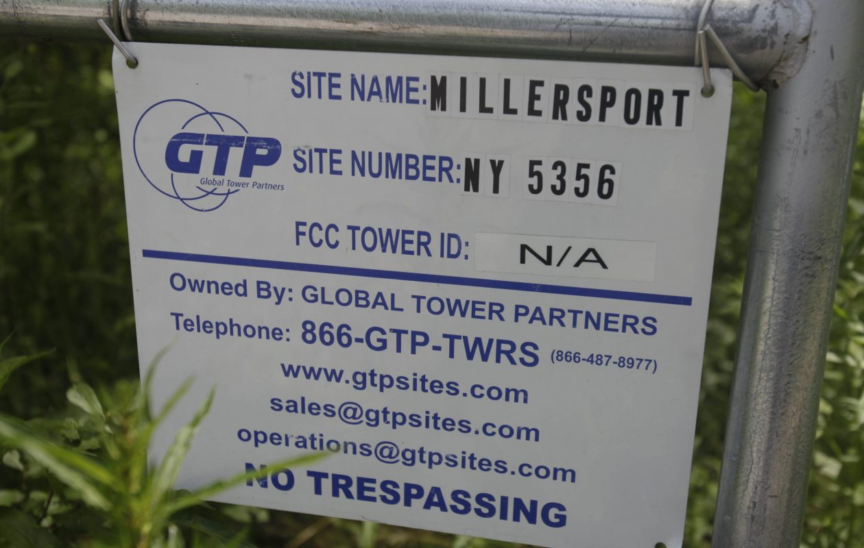 A sign at the gate to the access road to a cell tower site on Tonawanda Creek Road in Clarence. (Buffalo News file photo)