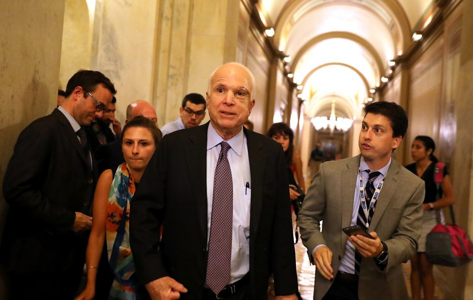 """Sen. John McCain, here leaving the Senate chamber after voting against the """"skinny repeal"""" legislation, has urged a bipartisan effort on health care. (Getty Images)"""