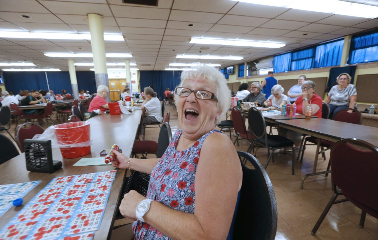 Sandy Noworyta reacts when another player yells 'Bingo!' at St. Andrew's Parish Hall in Sloan, N.Y., on Tuesday, July 18, 2017. bingo A new state law  bars anyone under 18 from playing bingo at a state licensed bingo hall.   (Robert Kirkham/Buffalo News)