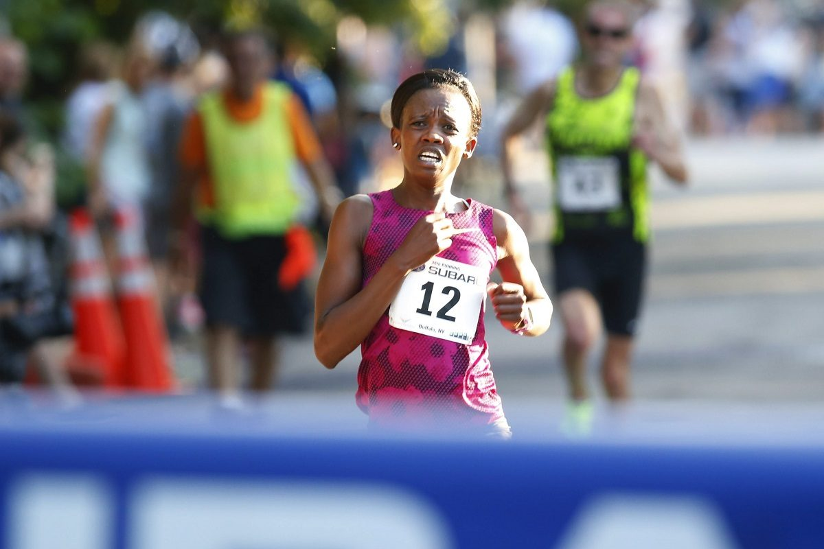 Monica Ngige was the first women to finish in the 2016 Subaru 4 mile chase on Friday, July 15, 2016. (Harry Scull Jr./Buffalo News)