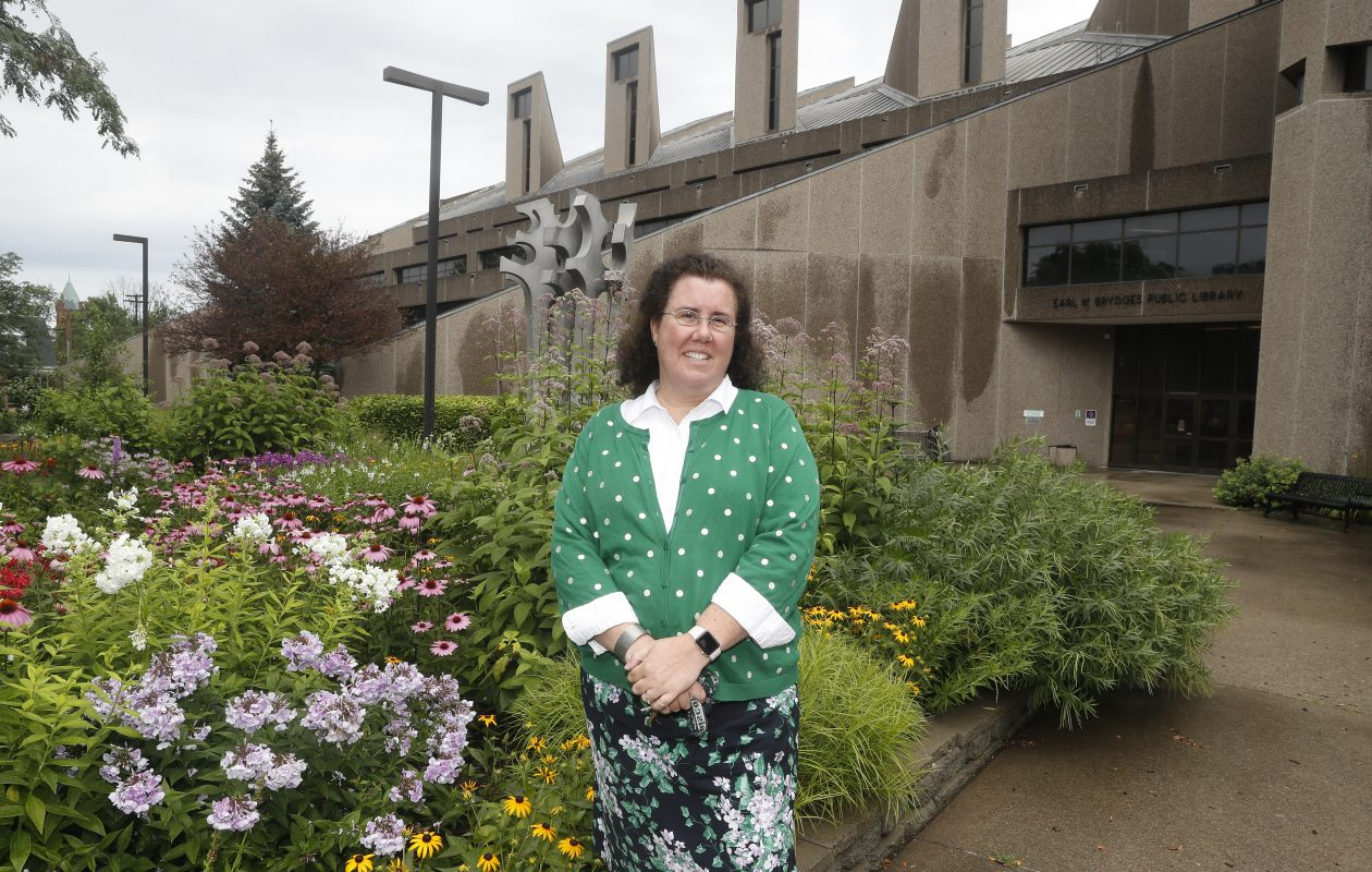 Sarah Potwin has started work as the new director of the Niagara Falls Public Library. She praised the work of volunteers who  planted native flowers in a bed outside the Earl W. Brydges library building at 1425 Main St. for the Falls Garden Walk. (John Hickey/Buffalo News)