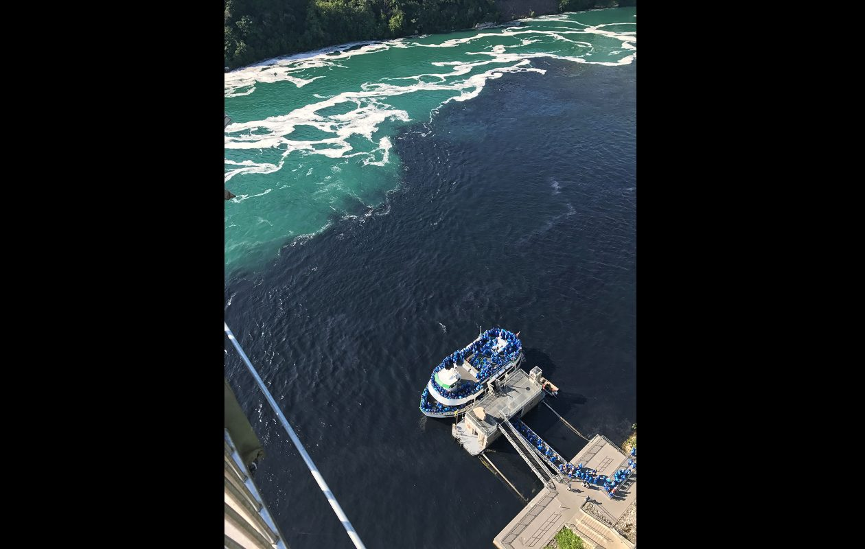 A photo showing a pool of dark water in the Niagara River surrounding the Maid of the Mist. (Photo courtesy Michelle Glynn)