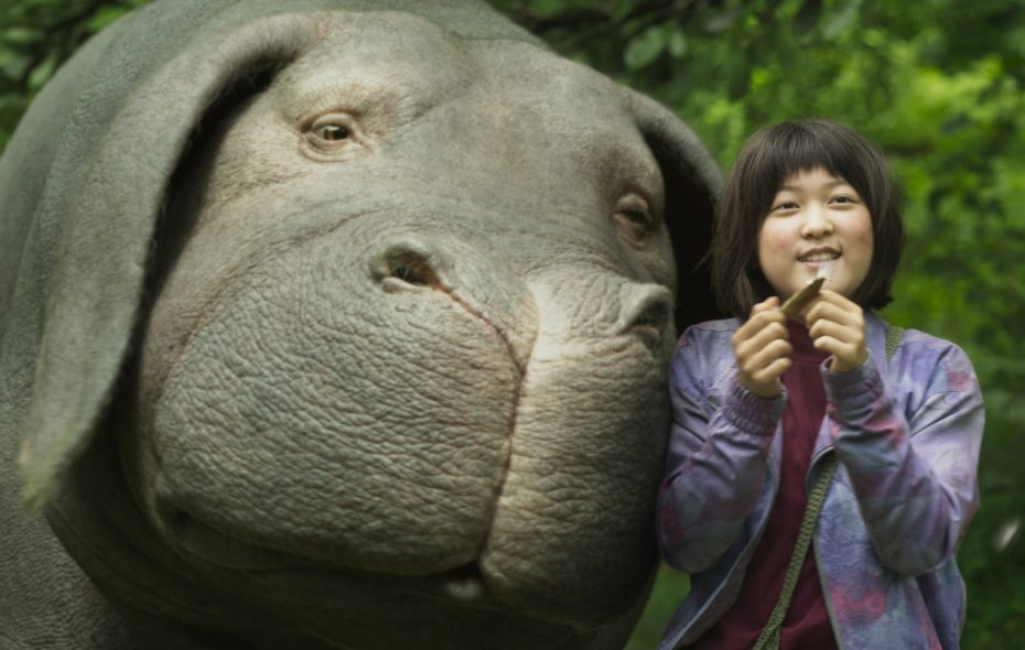 """Ahn Seo-hyun forms a special bond with a creature named """"Okja"""" in a new film now streaming on Netflix. (Photo courtesy Netflix.)"""