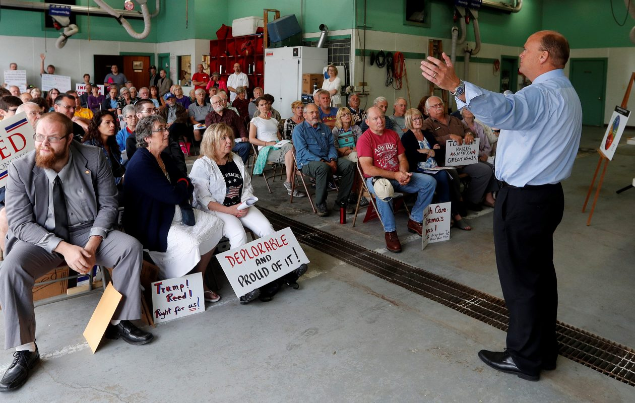 Rep. Tom Reed talks with constituents during a town hall meeting at the Belfast Fire Hall July 15.           (Mark Mulville/Buffalo News)