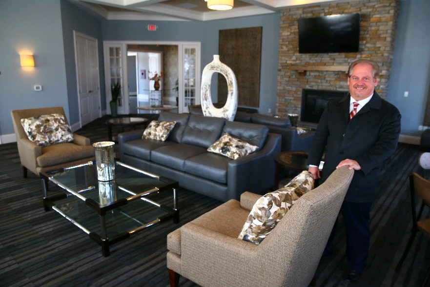 Anthony Cutaia, president of Rane Property Management, shows off the clubhouse at his Heron Pointe development on Grand Island. Rane is planning to expand its Dockside Village apartment complex in East Amherst onto Transit Road. (John Hickey/Buffalo News)