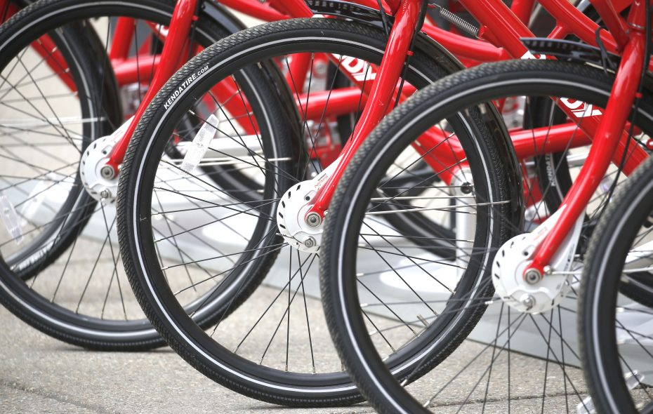 Two-hundred red bikes are available in spots across Buffalo through the Reddy Bikeshare rental program and membership is now half price through the rest of this season, which will stretch into November. (Robert Kirkham/Buffalo News)