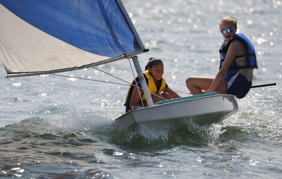 Kasandra Castro, left, and Brooke Willer, right, sail a dinghy on Lake Erie at the  Sail Buffalo Sailing School camp on Monday, July 31, 2017 in Buffalo, N.Y.  (Mark Mulville/Buffalo News)