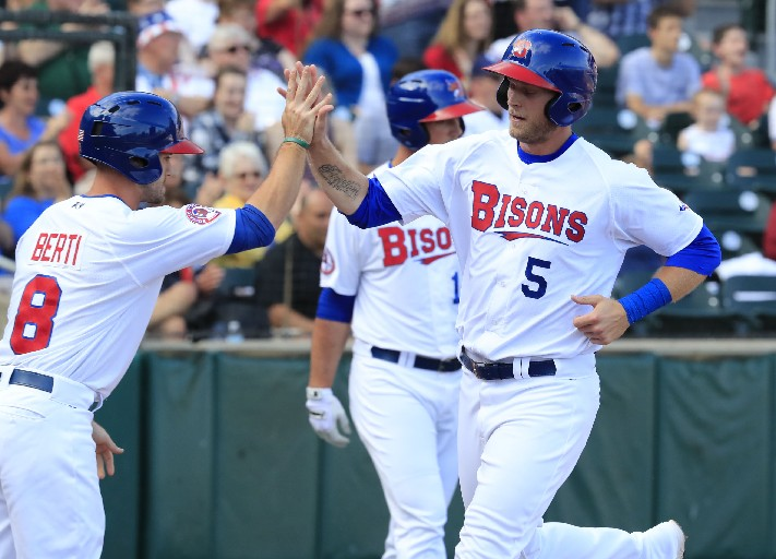 Michael Saunders (right) led the way as the Bisons' leadoff man on Saturday night. (File photo by Harry Scull Jr./Buffalo News)