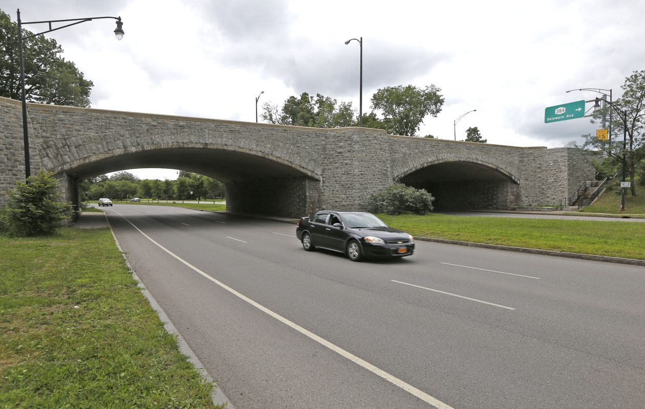 The stone arch bridge that carries the Scajaquada Expressway over Delaware Avenue would become a pedestrian and bike path. However, any plan to reroute the Scajaquada needs to take traffic flow into account. (Robert Kirkham/Buffalo News)
