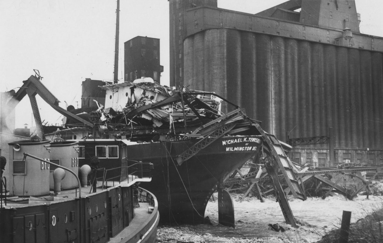 The Edward M. Cotter fireboat tends to the runaway Michael K. Tewksbury and the collapsed Michigan Avenue Bridge. (Photo courtesy of the Buffalo History Museum)