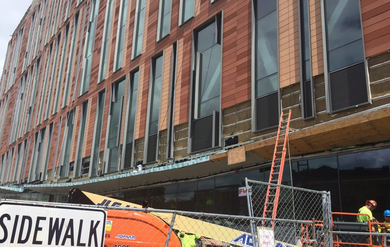 Workers continue installing terra cotta panels on exterior of UB's medical school. (Karen Robinson/Buffalo News)