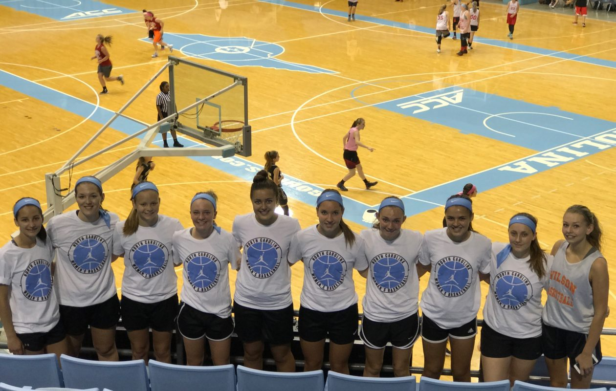 Nine members of the Wilson girls basketball team, from left, Maddie Mocarski, Morgan Faery, Sarah Lewis, Sarah Yousett, Shea Munnikhuysen, Amanda Murray, Julie Reagan, Skylar Munnikhuysen and Anna Frerichs, and Albion's Caitlynn Snook, far right, attended the University of North Carolina's Team Basketball Camp in June. (Photo provided by Brian Baker)