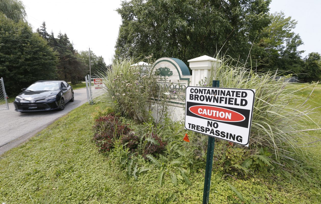 At the main entrance of the former Westwood Country Club on North  Forest Road in Amherst, a sign warned of pollution on the property. (Robert Kirkham/Buffalo News)