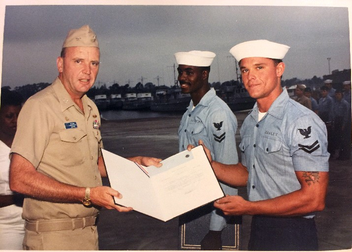 Navy Capt. Robert B. Bailey as a young sailor, right, receives an award early on in a career that he hopes will span 40 years and that has taken him from working on ships to teaching other sailors and overseeing curriculum. (Contributed photo)