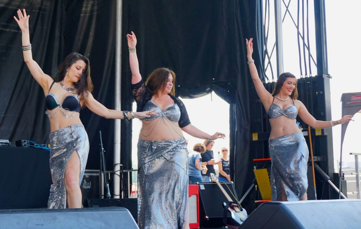 Jill Nykkei, center, and other members of her Fleuron Rouge belly dance troupe perform earlier this year at the Buffalo Pride Festival. Nykkei owns and teaches at the Bellydance Academy of Western New York. (Photo by Don Kreger/Special to The News)