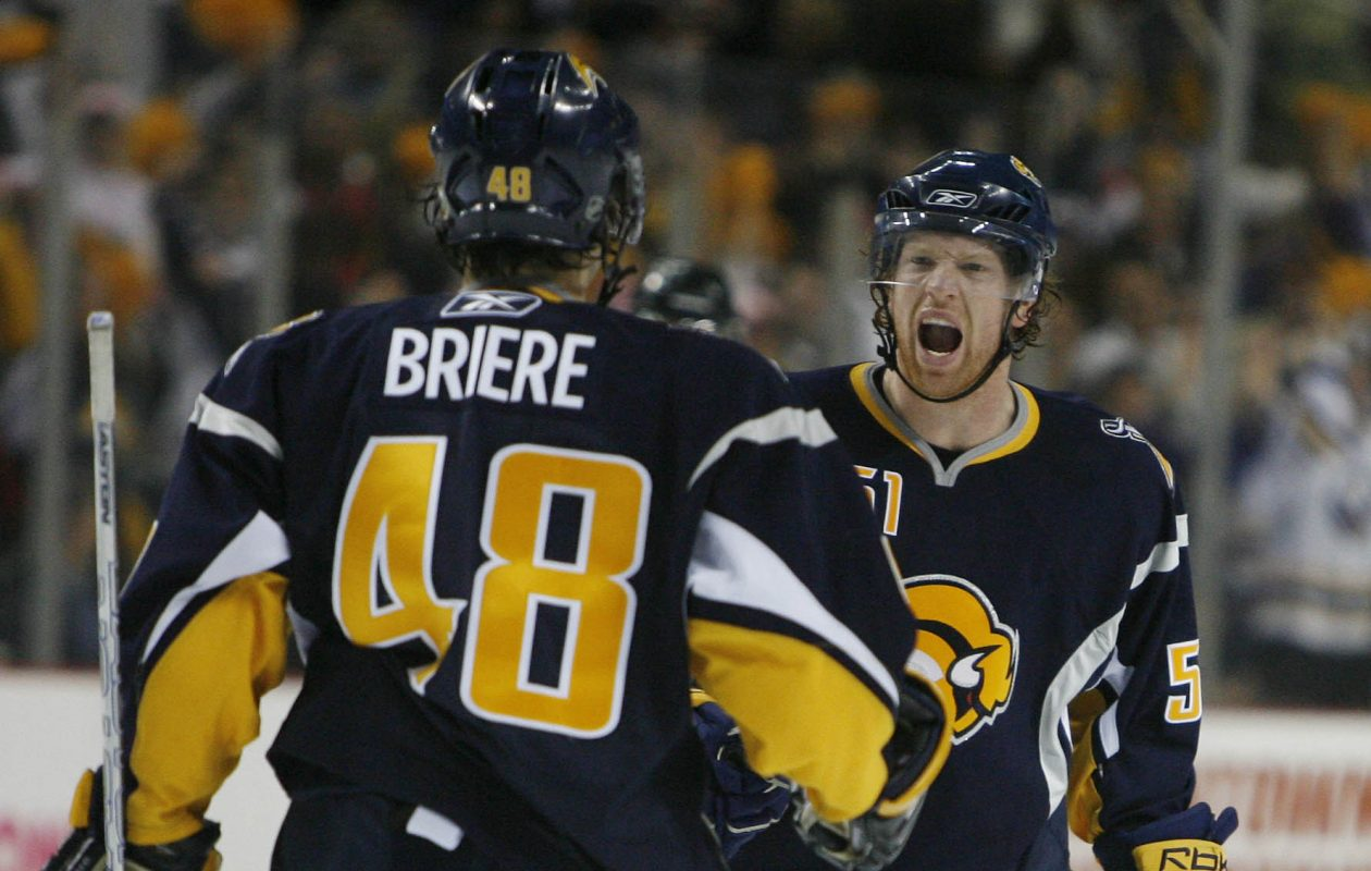 Brian Campbell celebrates the fourth Sabres goal (his second on the night) with Daniel Briere during the third period of Game One against the New York Islanders at HSBC Arena on April 12, 2007. (Mark Mulville/Buffalo News)