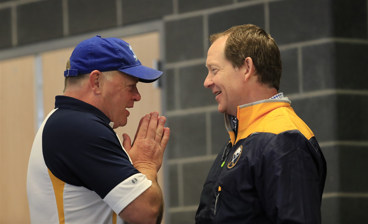 Danny Gare, left, visits with coach Phil Housley during the Sabres' 2017 development camp (Harry Scull Jr./News file photo).