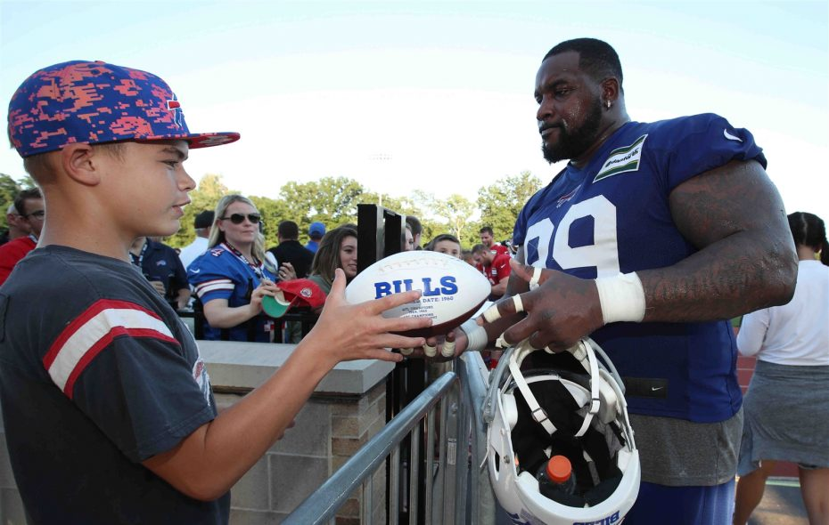 Bills defensive tackle Marcell Dareus signs autographs after a training camp practice (James P. McCoy/Buffalo News)