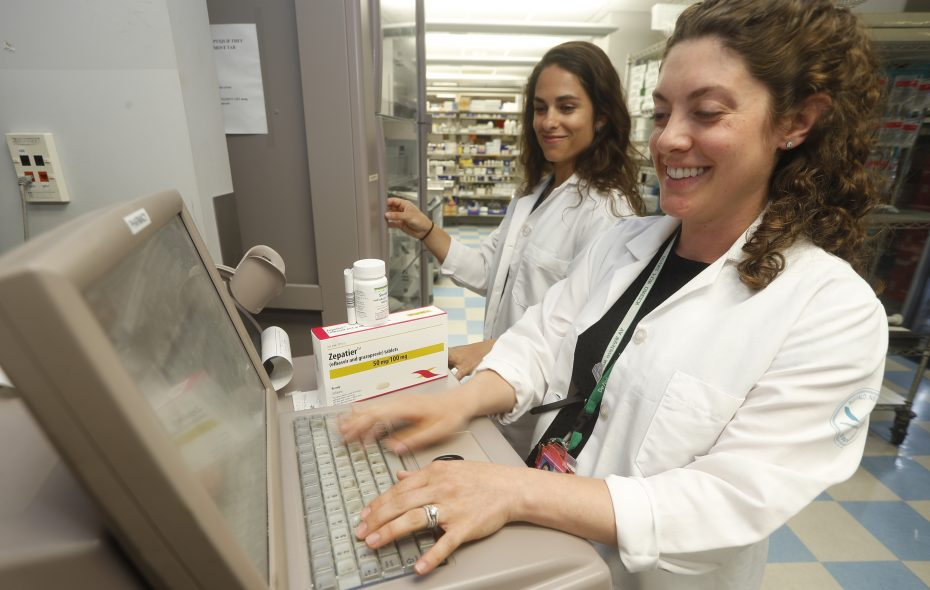 Infectious disease pharmacists Amy Horey, left, and Kari Kurtzhalts are among team members at the Buffalo Veterans Affairs Medical Center who have helped cure the vast majority of Hepatitis C cases treated through the Bailey Avenue  hospital in recent years. (John Hickey/Buffalo News)