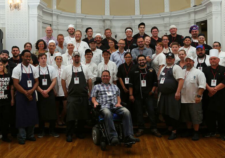 In 2015, Iron Event chefs and other event participants posed with former chef Dan Tracy.