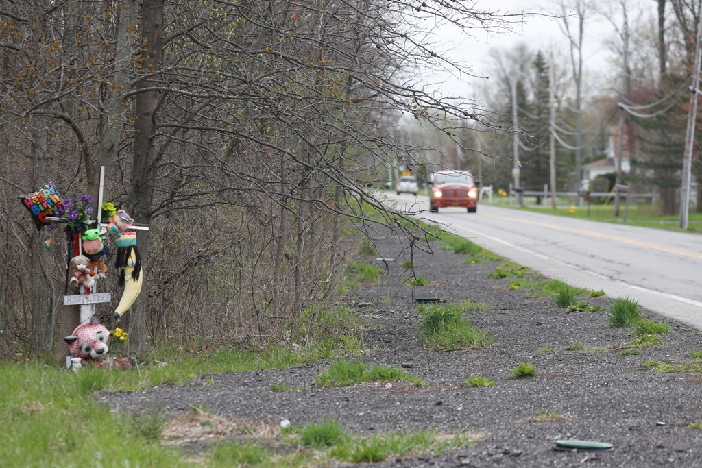 A roadside memorial to Ryan Fischer, shown on April 26, 2017, shows where the town filled in a drainage ditch after the fatality. (John Hickey/Buffalo News)