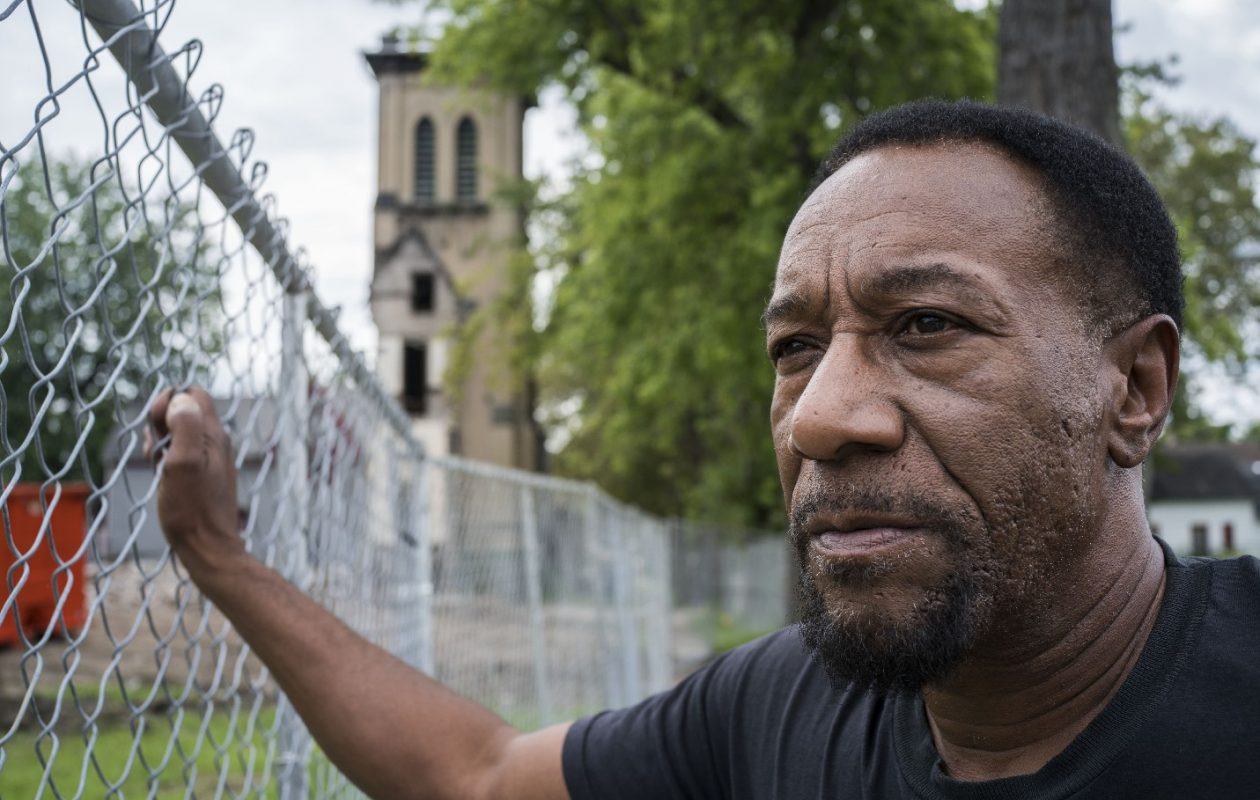Lamont Perry, who taught himself to play piano at the old Salem United Church of Christ, near the site where the church was recently demolished. The bell tower was left standing. (Derek Gee/The Buffalo News)