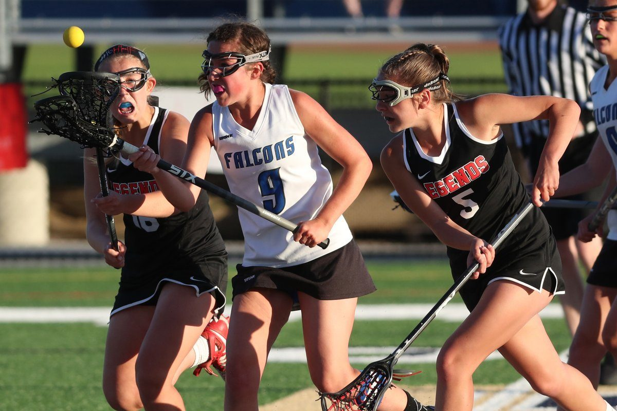 Frontier's Hannah Kennedy and Lancaster's Maddie Mazur (16) were two of the best girls lacrosse players in Western New York in 2017. (James P. McCoy / Buffalo News)