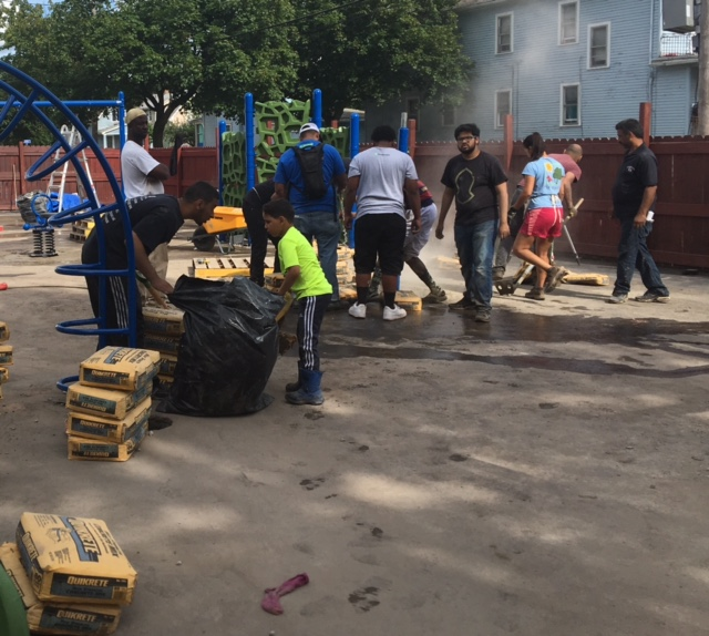 Volunteers help construct new playground near near Schiller Park.