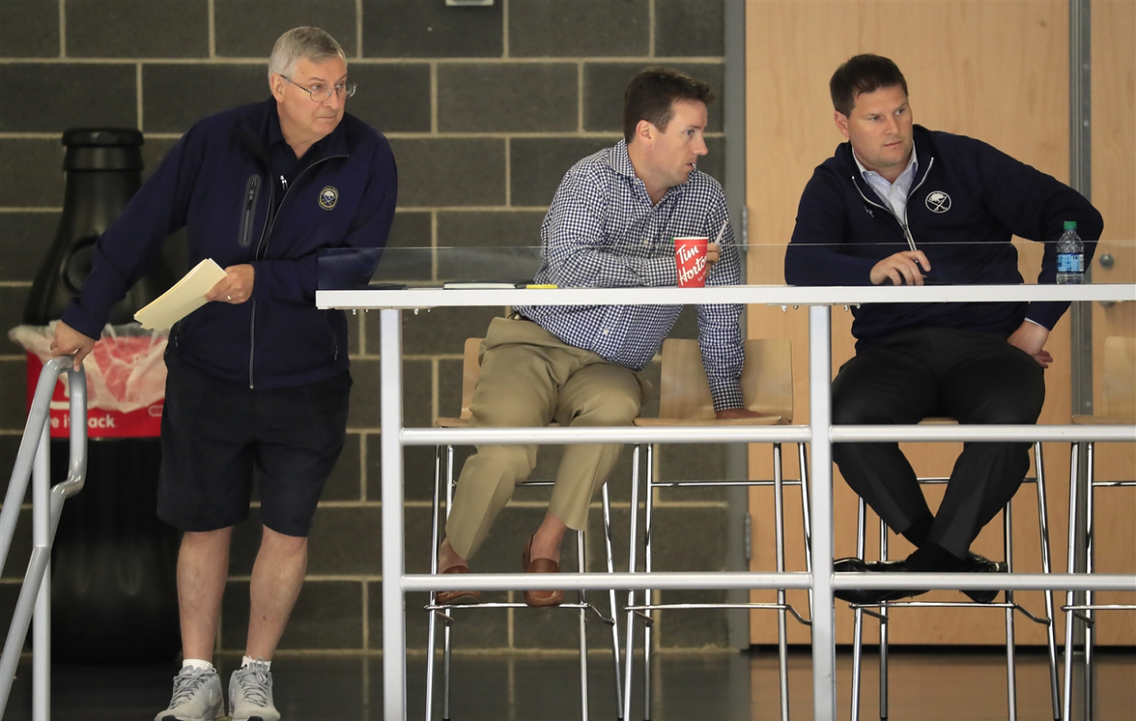 Steve Greeley (middle) chats with Jason Botterill as owner Terry Pegula looks on during development camp at HarborCenter in July. (Harry Scull Jr./News file photo)