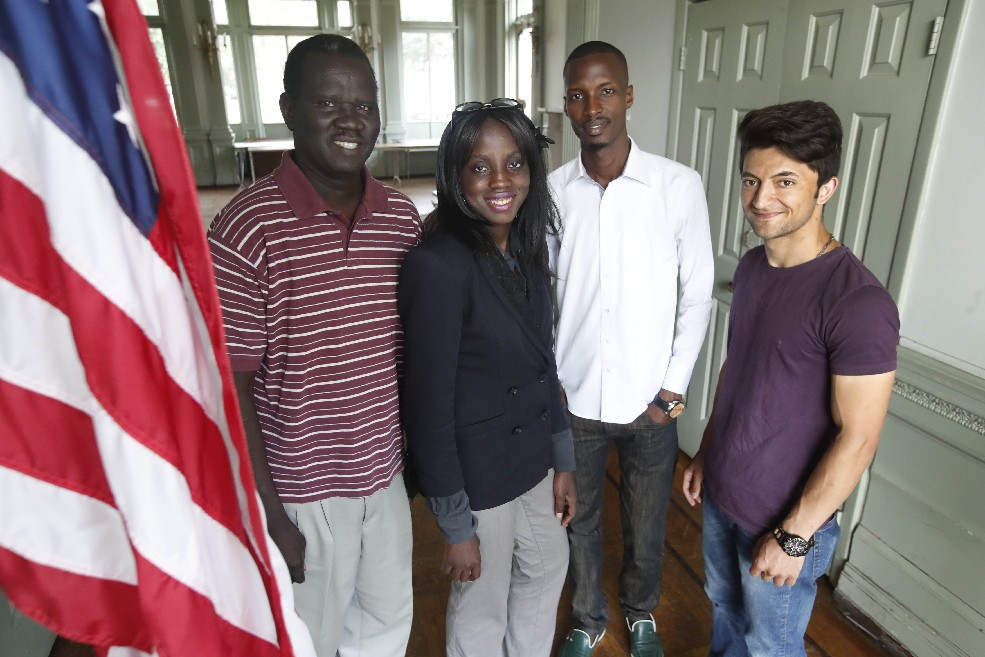 From left, Eisa Kodi of Sudan, Janice Nsamunmingi of the Democratic Republic of Congo, Gatungo Diop of Burundi and Afshin-Darabi of Afghanistan are among 14 refugees from five countries who graduated from a manufacturing training program at  the International Institute of Buffalo. (Sharon Cantillon/Buffalo News)