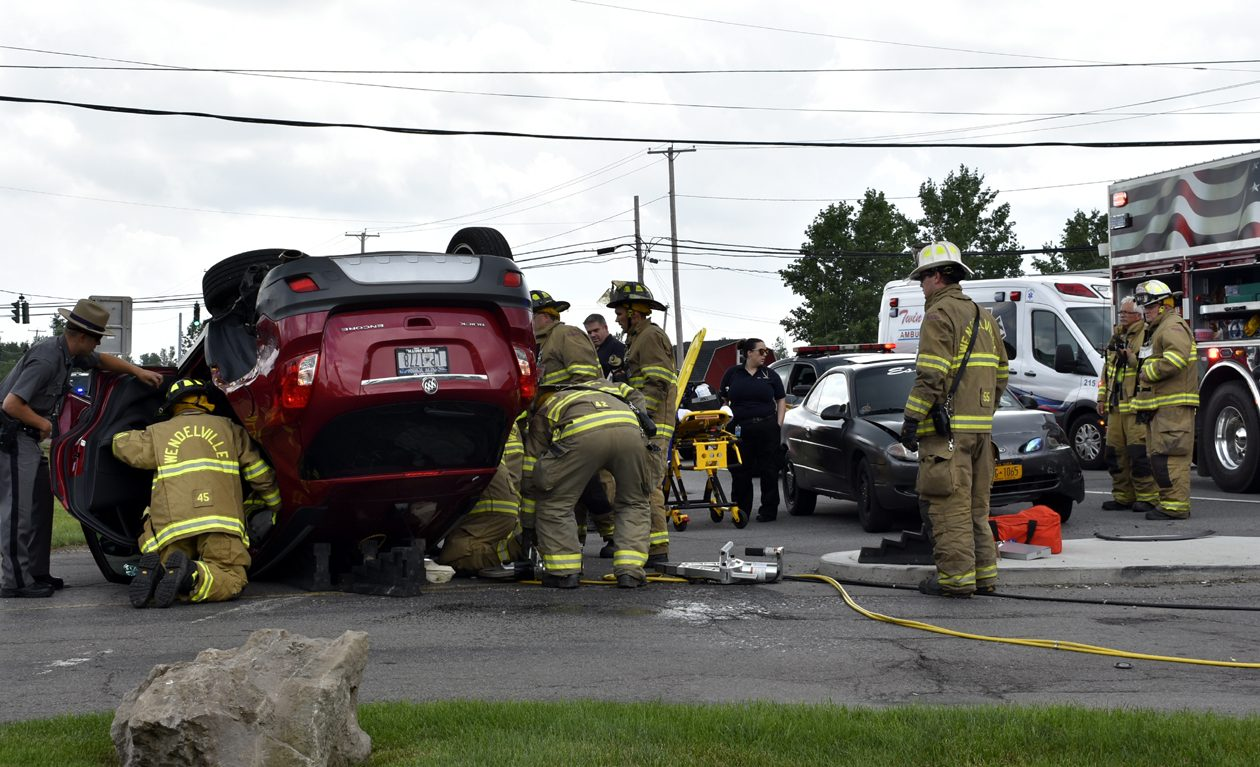 Emergency crews look for occupants in this Buick Encore that rolled over after a crash on South Transit Road in Lockport. (Larry Kensinger/Special to The News)