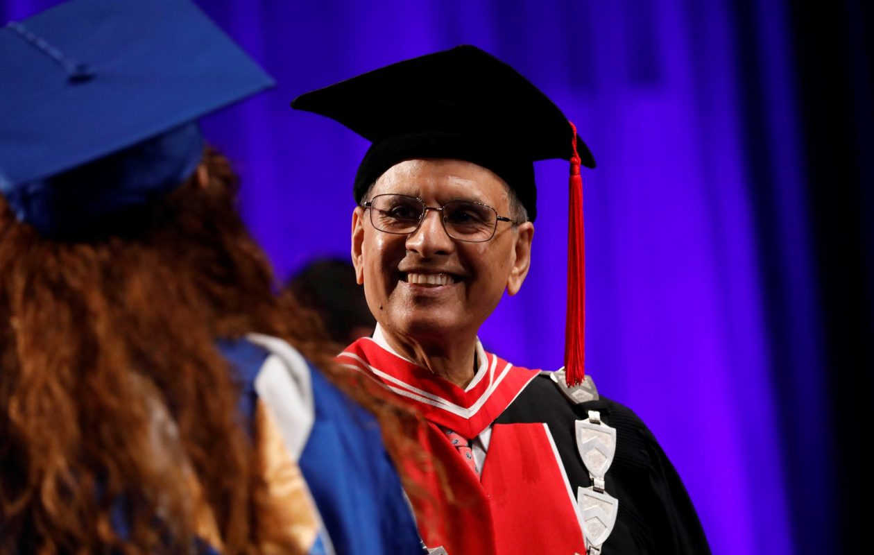 President Satish Tripathi greets graduates as they walk across the floor during the University at Buffalo commencement in Alumni Arena on May 21, 2017.  (Derek Gee/News file photo)
