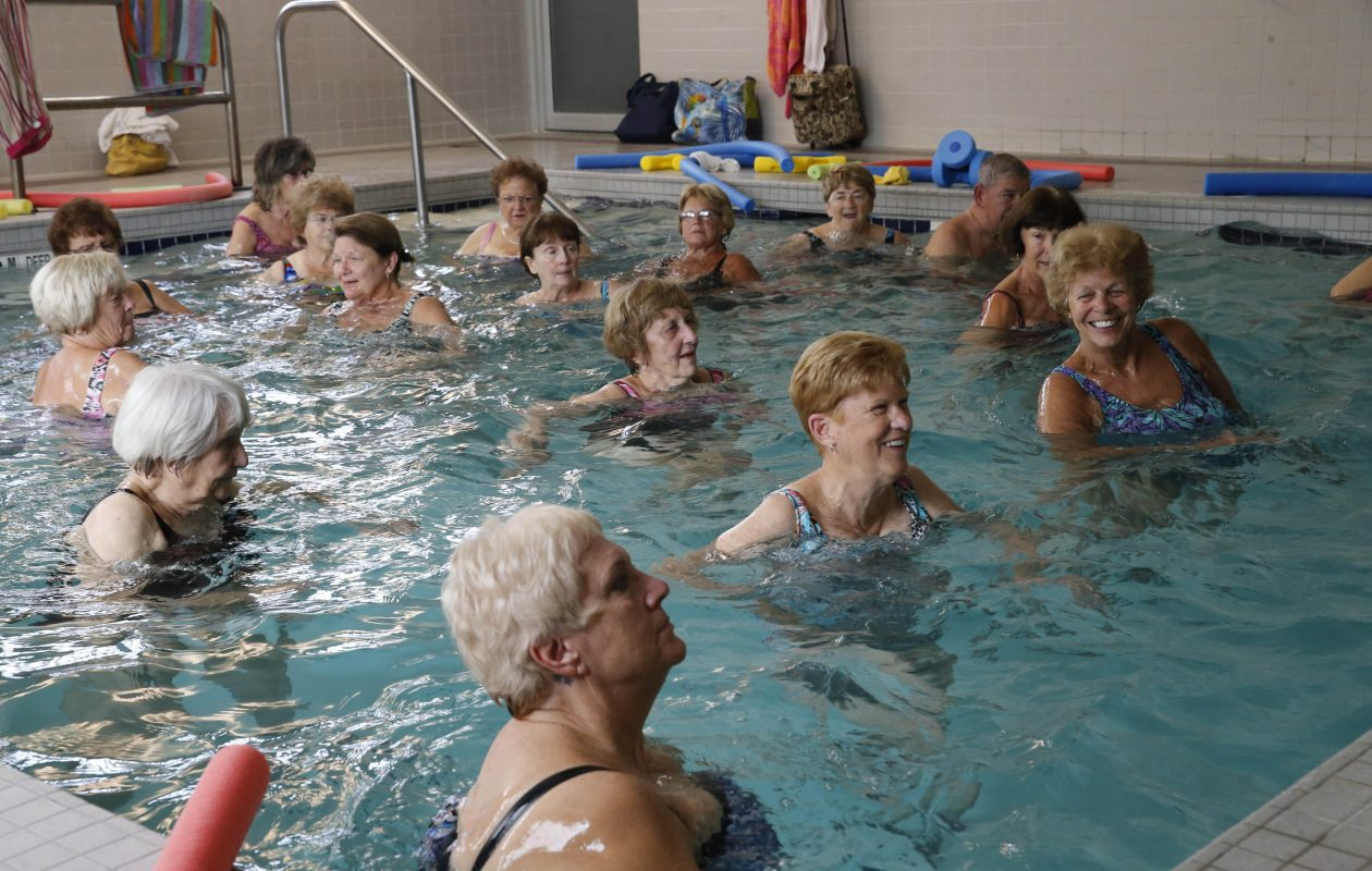 Some classes are filled at Hamburg's therapeutic pool on the Iris Apartments campus.  (file photo by Derek Gee/Buffalo News)