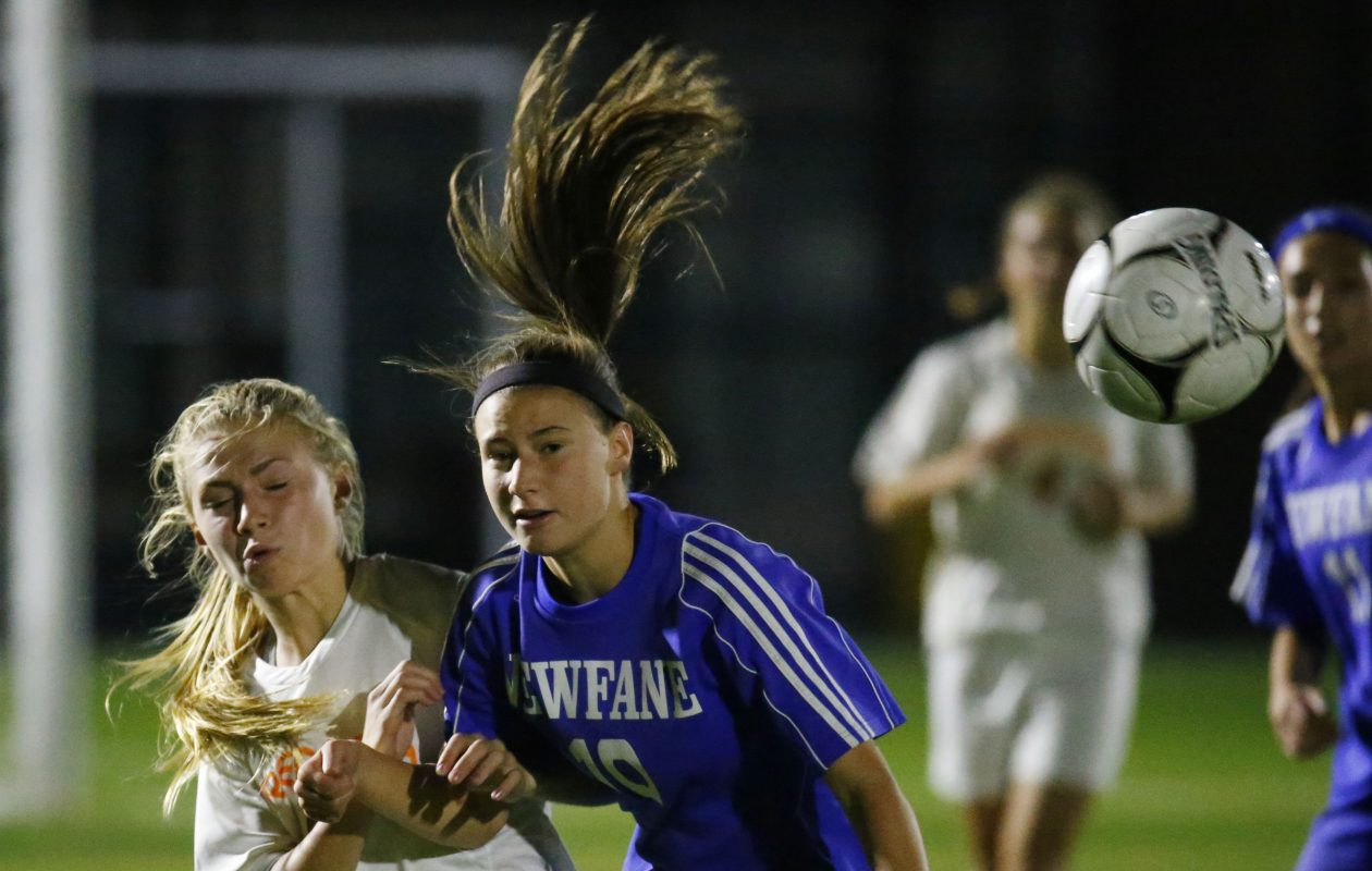 Newfane's Meghan Mietlicki and Fredonia's Kazlin Beers were among the many girls playing high school sports in the United States last year, according to a national study. (Harry Scull Jr./News file photo)