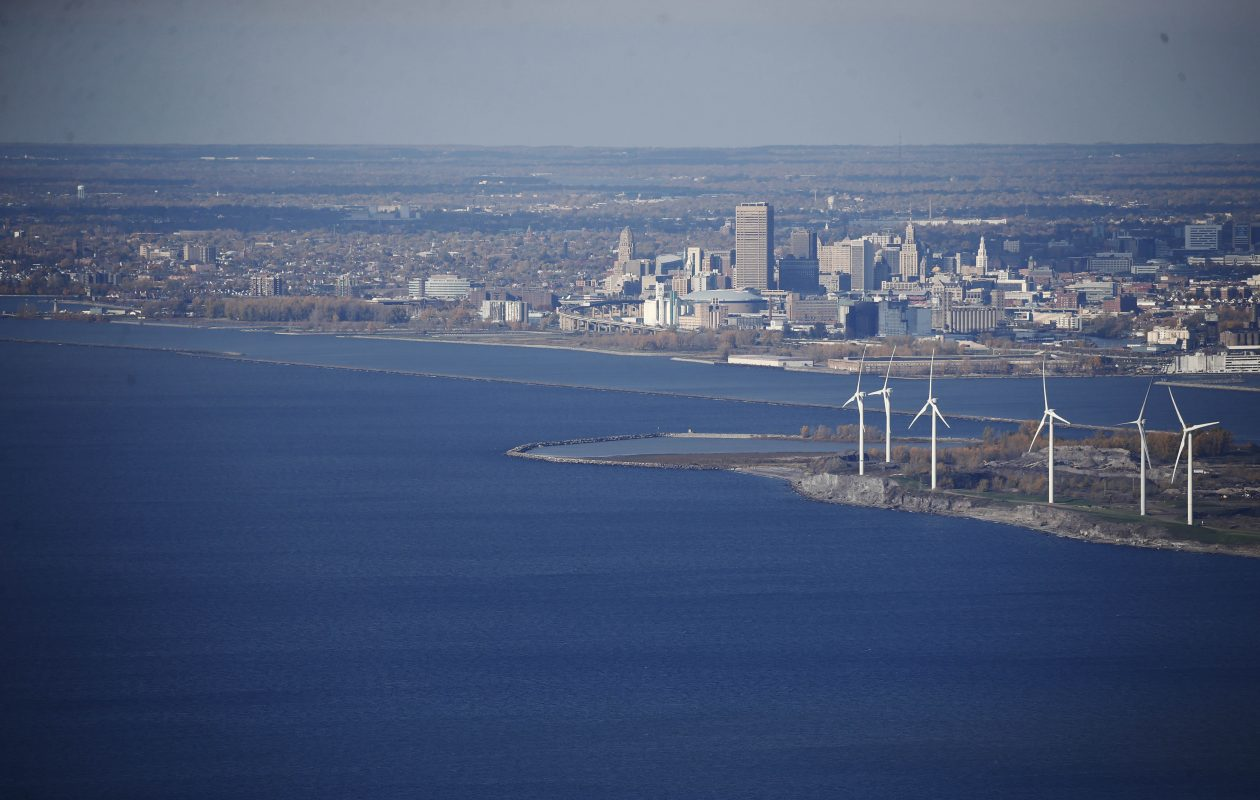 The Buffalo skyline rises up from the shore of Lake Erie, Friday, Nov. 4, 2016. At right is the Steel Winds wind energy farm on the former Bethlehem Steel site. (Derek Gee/Buffalo News)