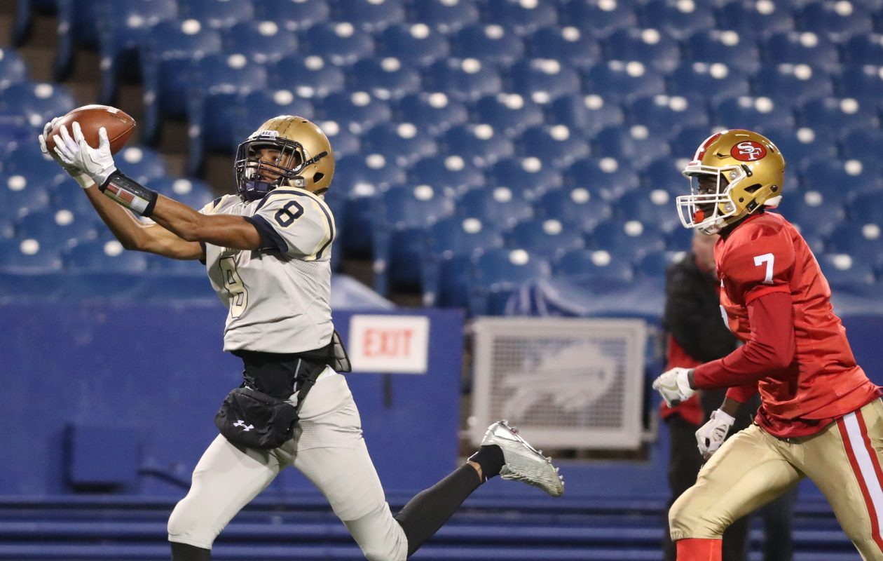 Canisius' Paul Woods beats St. Francis' Retsen Daley for a first-down catch during last year's Monsignor Martin championship game.  (James P. McCoy/Buffalo News file photo)